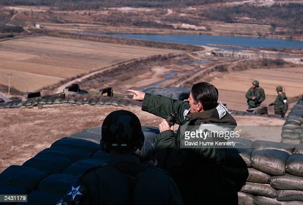 US President Reagan looks across the DMZ November 13 1982 at Guard Post Collier South Korea