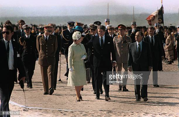 President Reagan places his hand on Queen Elizabeth's shoulderthose behind smile Olav of Norway salutes Left to right Prince Philip Baudovin of the...