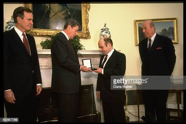 President Reagan presenting Soviet Jewish activist Natan Sharansky with Medal of Honor with VP Bush State Secretary Shultz