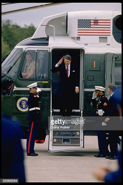 President Reagan returning salute of honor guard types standing on steps of Marine One arriving in Hartford CT