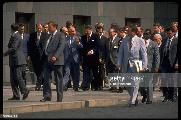 President Reagan Soviet leader Gorbachev out for summit stroll with entourage including WH aide Howard Baker