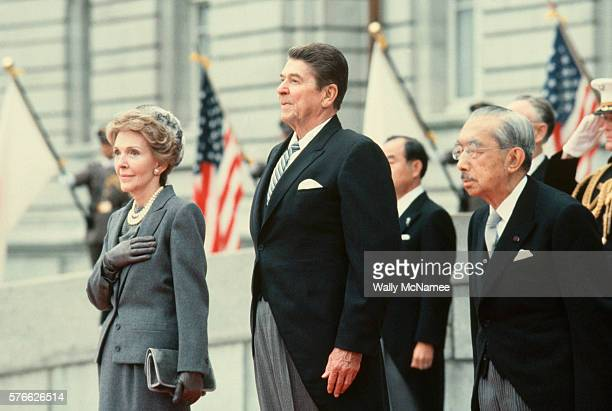 President Reagan the First Lady and Emperor Hirohito listen to the American anthem upon arriving at the Akasaka Detached Imperial Palace in Tokyo
