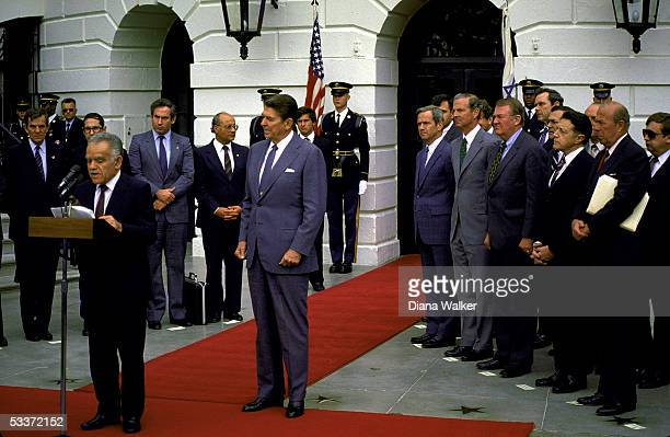 President Reagan with Israeli Prime Minister Shamir at departure ceremony. Right front row, L to R, NSC Advisor McFarlane, White House aides James...