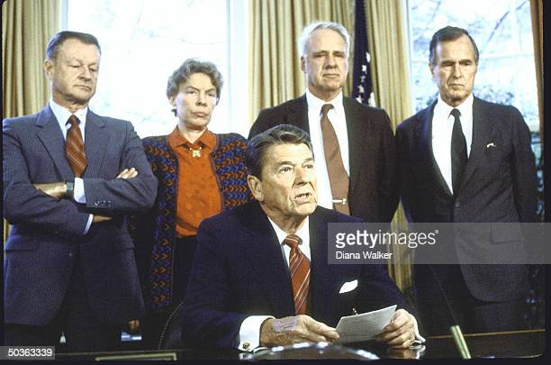 President Reagan with Zibigniew Brzezinski Jeane Kirkpatrick James Sclesinger and VP George Bush pitching White House Bill on Aid to Contras in...