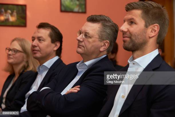 President Reinhard Grindel 2R0 and DFB Ambassador Thomas Hizlsperger visit The Don Bosco Children's Home on June 16 2017 in Moscow Russia