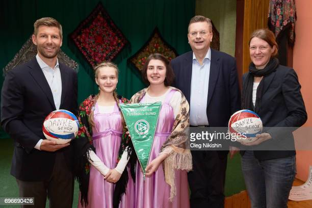 President Reinhard Grindel and DFB Ambassador Thomas Hizlsperger during their visit The Don Bosco Children's Home on June 16 2017 in Moscow Russia
