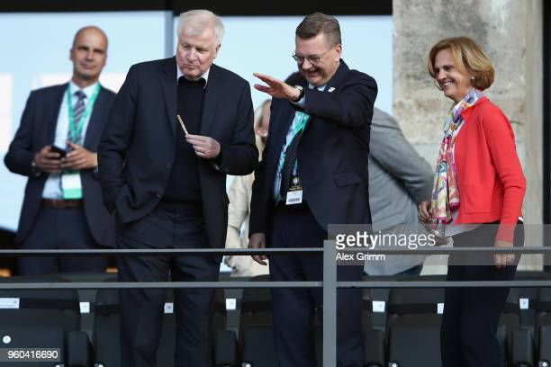 President Reinhard Grindel and German Interior Minister Horst Seehofer chat prior to the DFB Cup final between Bayern Muenchen and Eintracht...