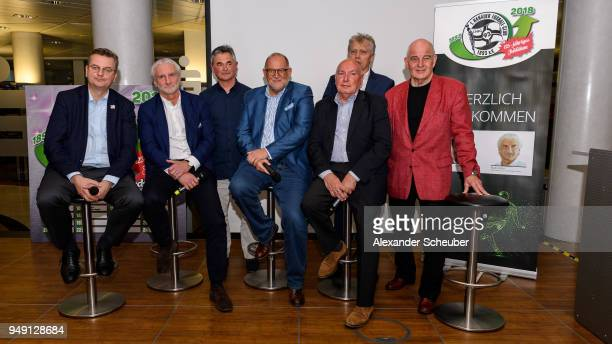 President Reinhard Grindel and Rudi Voeller pose with players of the 1978/1979 season of Hanauer FC during the 125th anniversary of 1 Hanauer FC on...