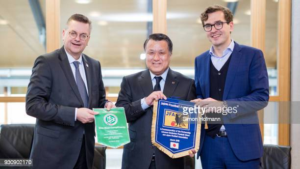 DFB President Reinhard Grindel JFA President Kozo Tashima and DFB General Secretary Dr Friedrich Curtius pose of a group picture after signing a...