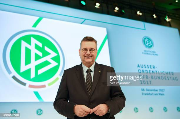DFB President Reinhard Grindel poses at the extraordinary federal conference of the German Football Association  in Frankfurt/Main Germany 8 December...