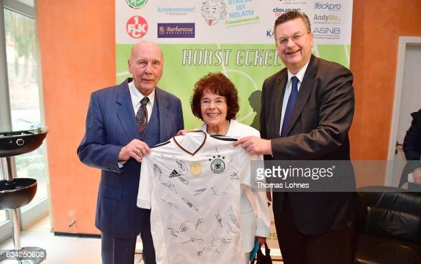 President Reinhard Grindel presents Horst Eckel, who won the 1954 FIFA World Cup with the German National Team, a trikot of the German National Team...