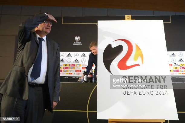 President Reinhard Grindel presents the official new DFB logo for Germany as Candidate for the UEFA Euro 2024 during a DFB Press Conference at Hotel...