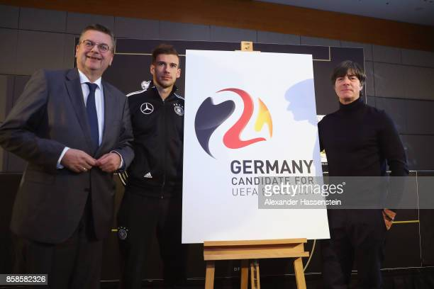 President Reinhard Grindel presents with Leon Goretzka of Germany and Joachim Loew head coach of Germany the official new DFB logo for Germany as...