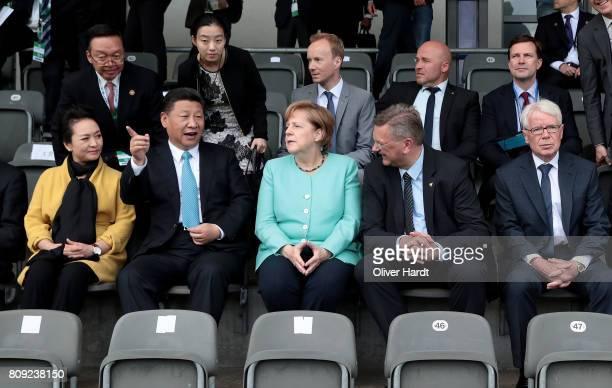 President Reinhard Grindel , President XI Jinping of China , German Chancellor Angela Merkel and Reinhard Rauball , President of German Football...