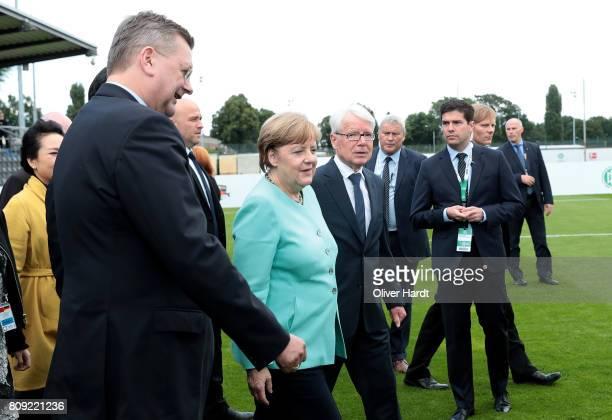 President Reinhard Grindel, Reinhard Rauball, President of German Football League and German Chancellor Angela Merkel attend the Chinese German...