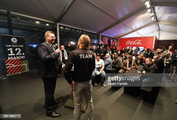 President Reinhard Grindel talks to members of the fan club prior to the International Friendly match between Germany and Russia at Red Bull Arena on...