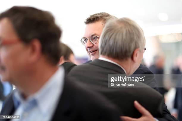 DFB president Reinhard Grindel welcomes a delegate prior to the Extraordinary DFB Bundestag at Messe Frankfurt on December 8 2017 in Frankfurt am...