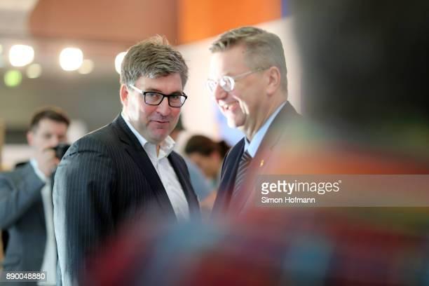 DFB president Reinhard Grindel welcomes Eintracht Frankfurt CEO Axel Hellmann prior to the Extraordinary DFB Bundestag at Messe Frankfurt on December...