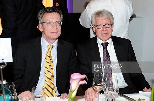 President Reinhard Rauball and Minister of Defence Thomas de Maiziere pose during the dinner to celebrate their German Bundesliga 2010/2011 victory...