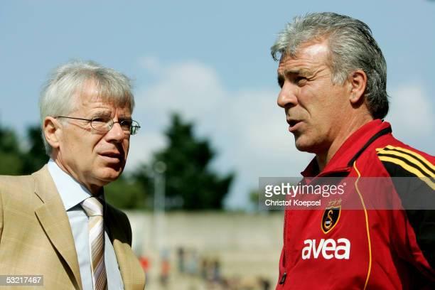 President Reinhard Rauball of Dortmund speaks to heasd coach Erik Gerets of Galatasaray during the friendly match between Borussia Dortmund and...