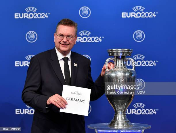 President Reinhart Grindel on stage following the announcement of Germany as the bid winners during the UEFA EURO 2024 host city announcement at the...