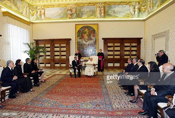President Ricardo Maduro of Honduras talks with Pope John Paul II during their private meeting at Vatican 17 May 2004 AFP PHOTO/ POOL/Claudio ONORATI