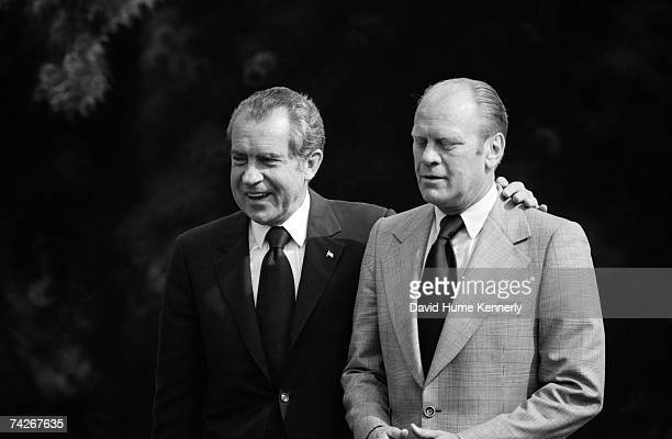 President Richard M. Nixon and Vice President Gerald R. Ford arrive prior to the President giving a speech on the White House lawn on June 19, 1974...