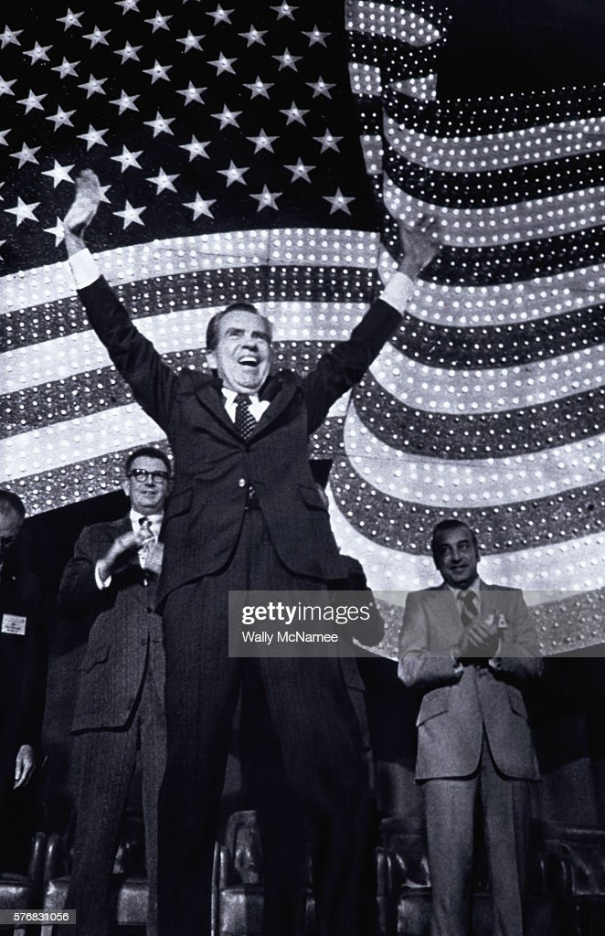 President Richard M. Nixon waves his arms to a crowd of supporters prior to his speech at a convention in Washington, DC. The President is speaking at the convention in hopes of raising support during the height of criticism concerning his role in the Watergate affair.
