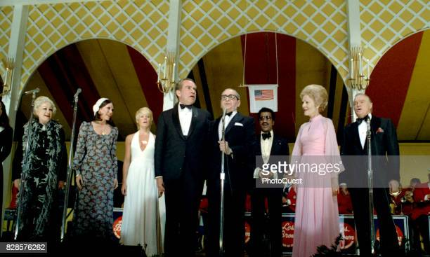 US President Richard Nixon and composer Irving Berlin sing as they perform onstage at a Vietnam POW dinner at the White House Washington DC May 24...