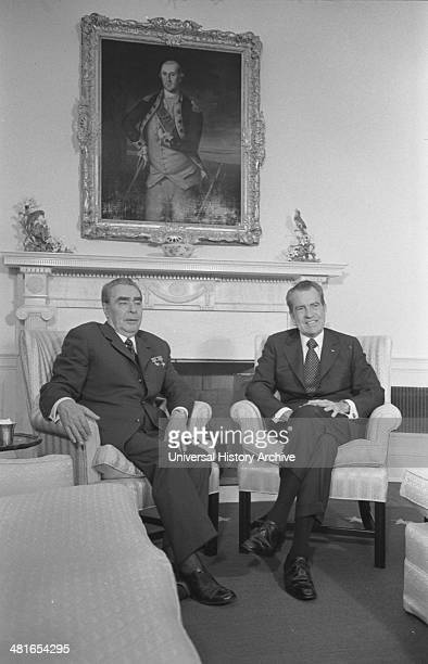 US President Richard Nixon and Soviet leader Leonid Brezhnev seated in the White House with a portrait of George Washington in the background June...