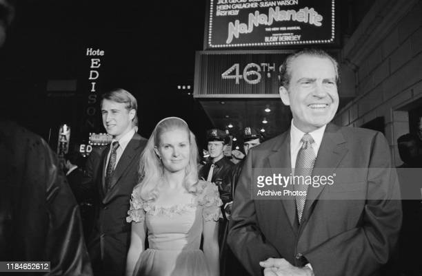 US President Richard Nixon attends a showing of the Broadway musical 'No No Nanette' at the 46th Street Theatre in New York City with his daughter...