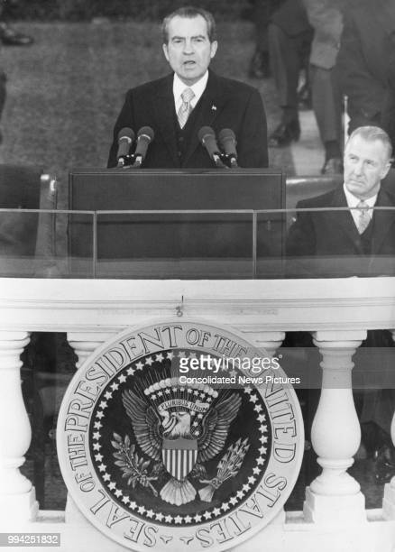 US President Richard Nixon delivers his inaugural address after taking the Oath of Office for his second term Washington DC 20th January 1973 Vice...