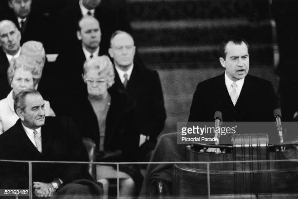 US President Richard Nixon delivers his inaugural address at the US Capitol Washington DC January 20 1969 Outgoing president Lyndon B Johnson listens...