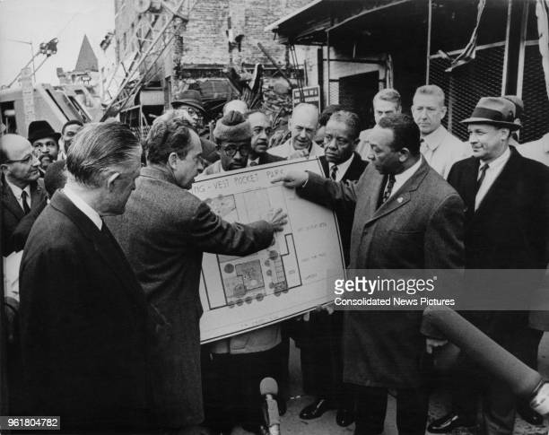 US President Richard Nixon discusses the plans to rebuild the 7th Street ghetto area of Washington DC with George W Romney Secretary of Housing and...