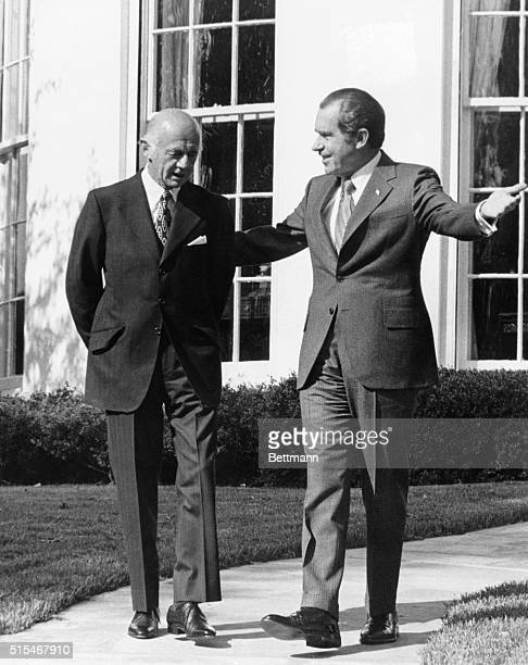 President Richard Nixon escorts Australian Prime Minister William McMahon from the White House after the two world leaders met informally there 11/2...
