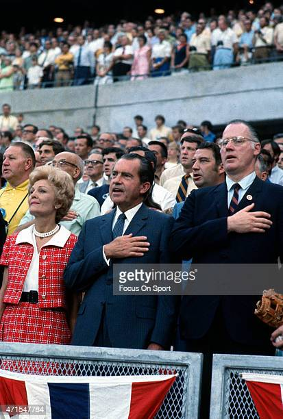 President Richard Nixon First Lady Pat Nixon and commissioner of baseball Bowie Kuhn stands for the National Anthem prior to the start of Major...