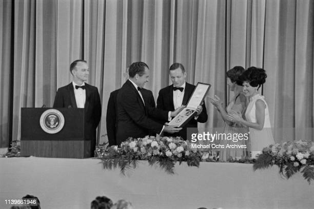 US President Richard Nixon hosts a dinner at the Century Plaza Hotel in Los Angeles for the Apollo 11 astronauts and presents them with the...