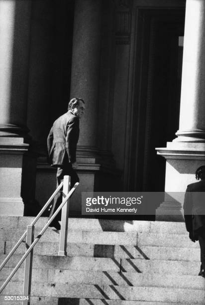 US President Richard Nixon hurries up the steps of the Executive Office Building after briefing Congressional leaders in the Middle East Crisis on...