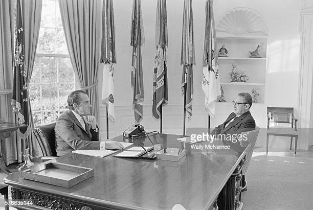 President Richard Nixon meets with National Security Affairs Advisor Henry Kissinger in the Oval Office.