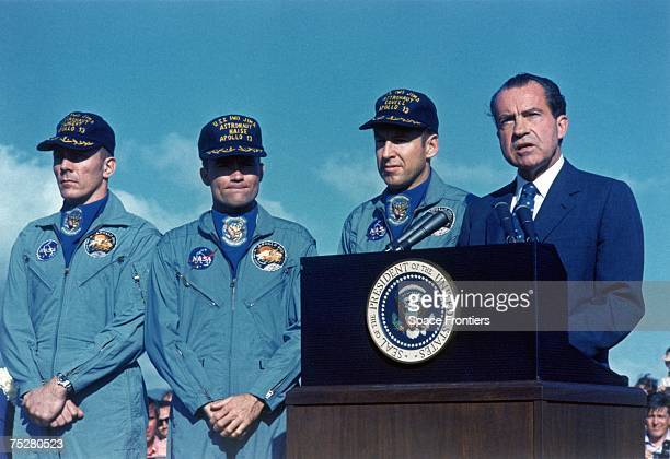 US president Richard Nixon presents the Apollo 13 astronauts with the Presidential Medal of Freedom at Hickam Air Force Base Hawaii upon their return...