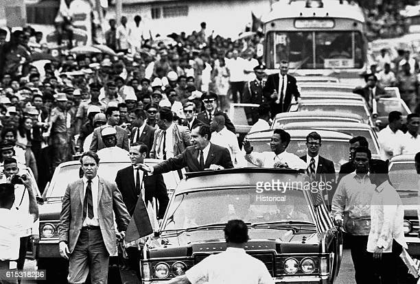 President Richard Nixon rides in a motorcade after his arrival in Manila Philippines | Location Manila Philippine
