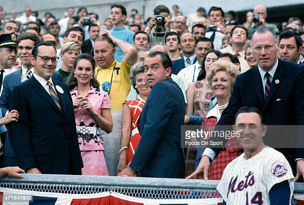 President Richard Nixon set to throw out the ceremonial first pitch as commissioner of baseball Bowie Kuhn and and manager Gil Hodges of the Mets...