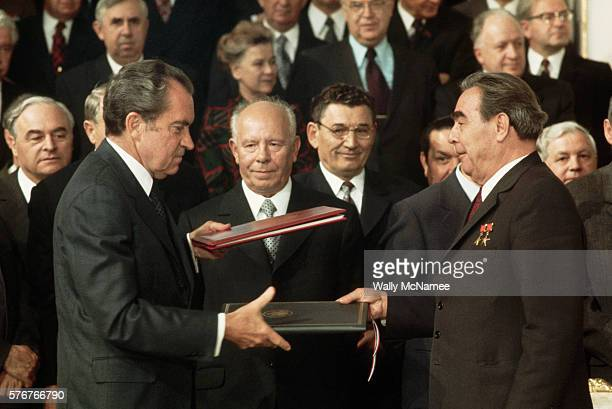 President Richard Nixon shakes hands with Leonid Brezhnev after the signing of the SALT treaty Among those in the audience in the front row between...