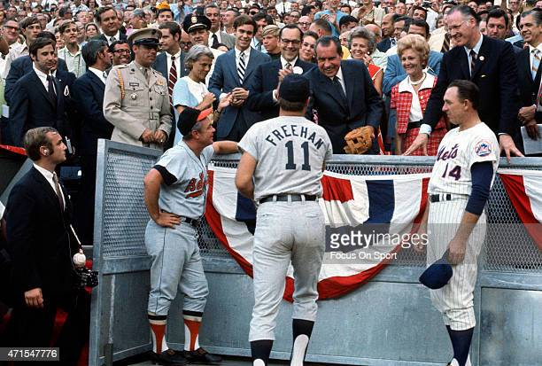 President Richard Nixon shakes the hand of Bill Freehan of the Detroit Tigers of the American League as manager Earl Weaver of the Baltimore Orioles...