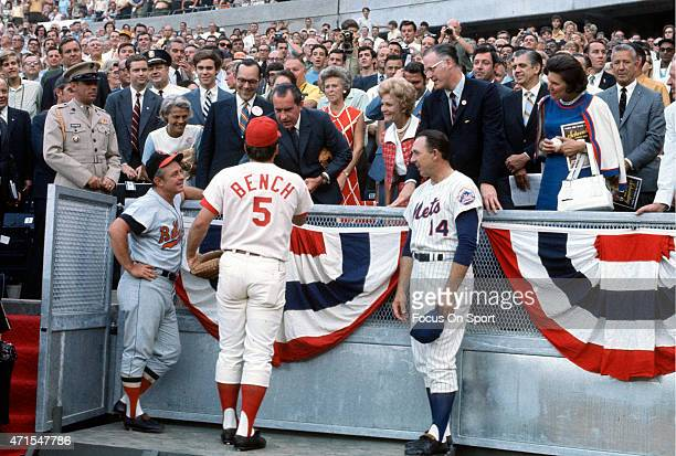 President Richard Nixon shakes the hand of Johnny Bench of the Cincinnati Reds as manager Earl Weaver of the Baltimore Orioles and manager Gil Hodges...
