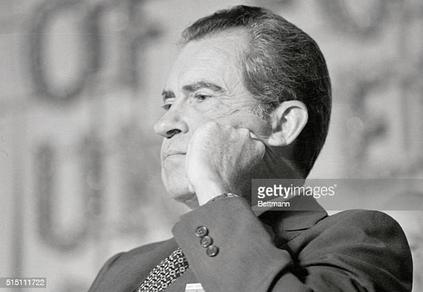 President Richard Nixon sits here, after listening to a whispered word from VFW Commander Patrick Carr before addressing the VPW Convention in the...