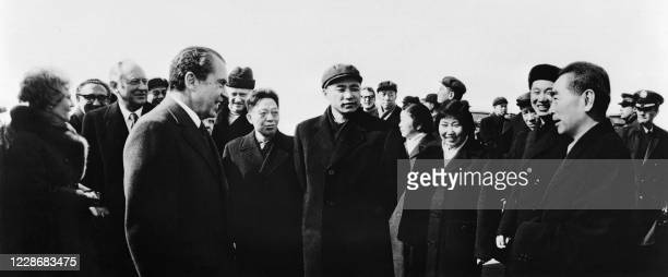 President Richard Nixon speaks with Chinese Prime minister Zhou Enlai before leaving Shanghai after their visit on February 1972 during an official...