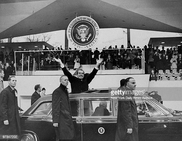 President Richard Nixon stands in car during the inaugural parade