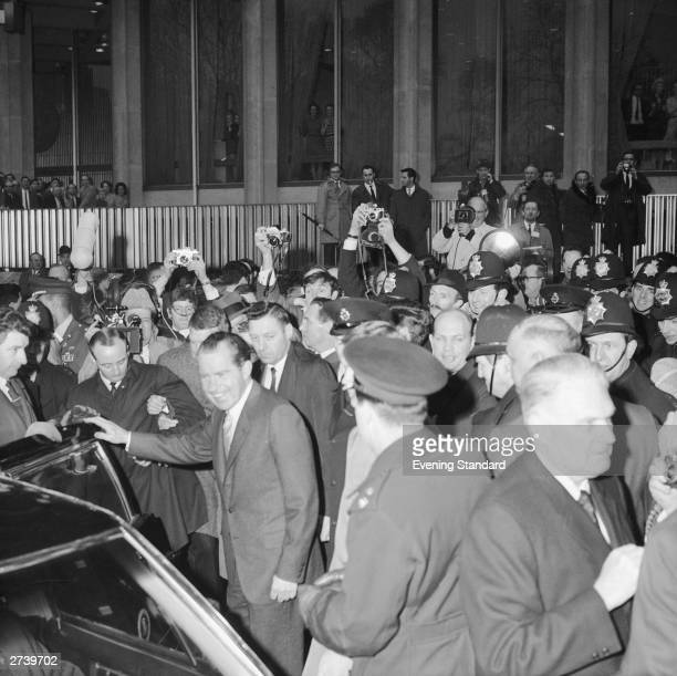 US President Richard Nixon surrounded by press photographers and policemen outside the American Embassy during a visit to London 5th March 1969