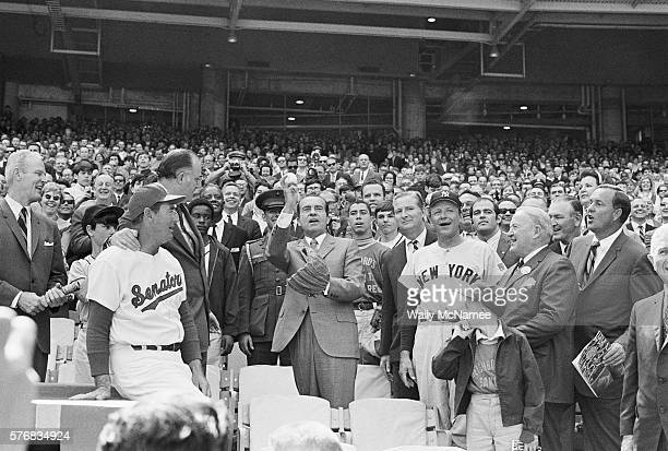 President Richard Nixon throws out the first pitch of the baseball game as Washington Senators manager Ted Williams Baseball Commissioner Bowie Kuhn...